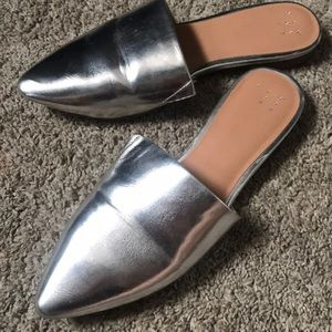 A. New. Day silver mules (worn once)